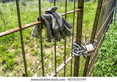 Metal old fence closed with padlock and security chain - stock photo