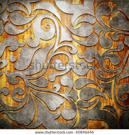 Metal ornament on old wooden background (vintage collection) - stock photo