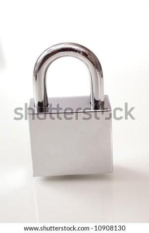 Metal padlock over white background - stock photo