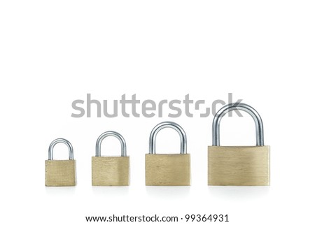 Metal padlocks of different sizes on white background - stock photo