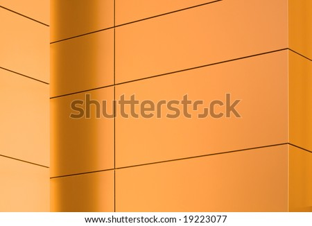 Metal panels on a side of a modern building glowing in the sunset light #3 - stock photo