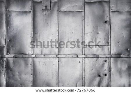 Metal panels on industrial door or wall - stock photo