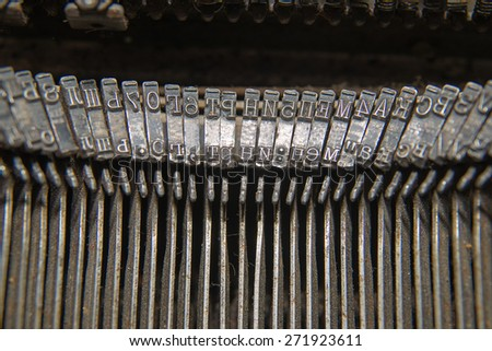 Metal parts for printing documents on an old typewriter