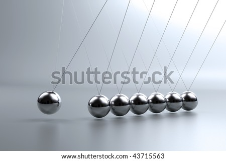 Metal pendulum balls balancing from strings in Newton's cradle - stock photo