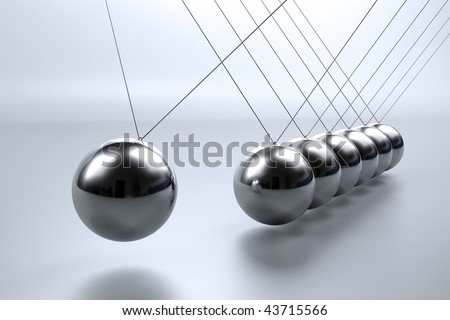 Metal pendulum balls balancing from strings in Newton's cradle - stock photo
