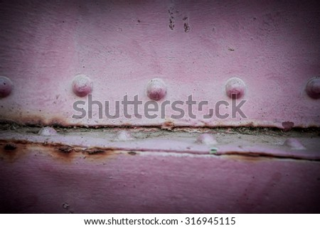 Metal pink background. Grunge background metal plate with screws - stock photo