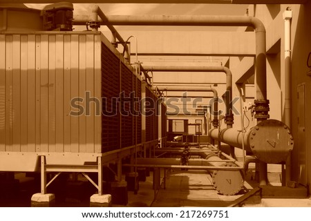 Metal pipe vent in an old factory - stock photo