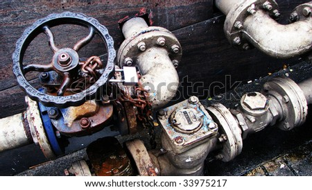 Metal Pipes Locks Levers Valves - stock photo
