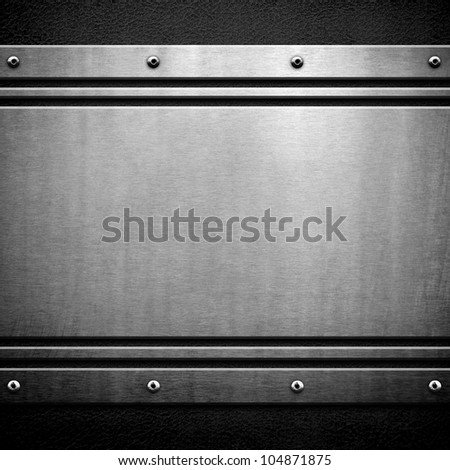 metal plate on black leather - stock photo