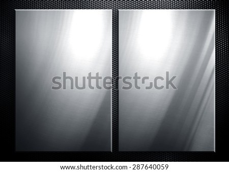 metal plate on metal mesh background - stock photo