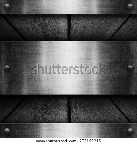 Metal plate on old wooden background for design - stock photo