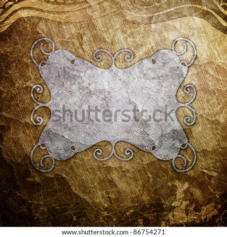 Metal plate on ornate golden wall