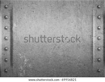 Metal plate or armour texture with rivets - stock photo