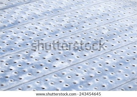 metal plate perforated   -illustration based on own photo image - stock photo