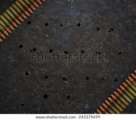 Metal plate with holes from bullets and cartridges - stock photo