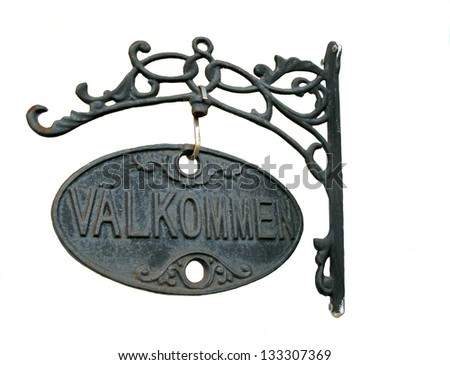 """Metal plate with the word """"Wellcome"""" in Swedish - stock photo"""