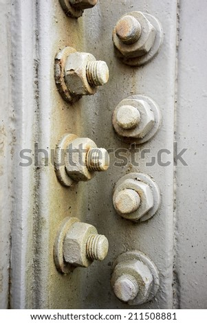 Metal plates at a construction held together by screws and nuts/Metal Construction Detail - stock photo