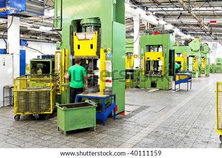 Metal production heavy machines and factory interior - stock photo