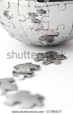 Metal puzzle globe close-up,  isolated on white background - stock photo