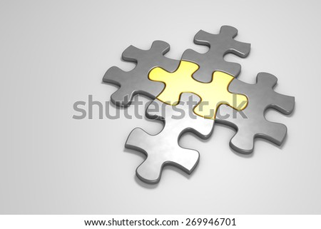 Metal puzzle pieces on a white floor, one piece in gold - stock photo