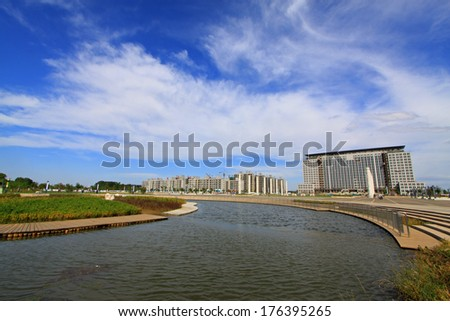 Metal railings and wooden floor at the side of the river, Luannan, china - stock photo