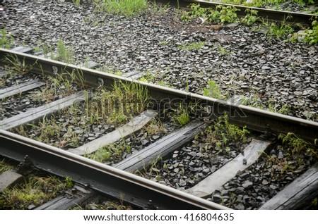 Metal railway track with nobody around - traveling conceptual photo - stock photo