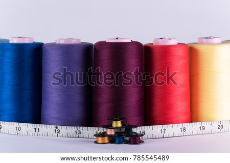 metal rollers, bobbins and textile measure