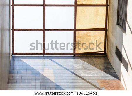 Metal roof of the old building is shining in summer time. - stock photo