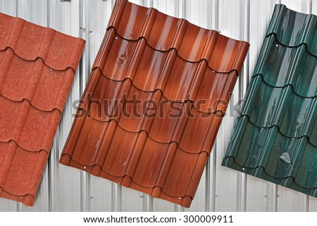 Metal roof painted by red, brown, green color for sale - stock photo