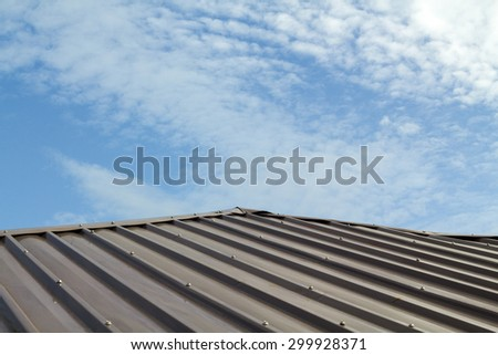 Metal roof with blue sky background.