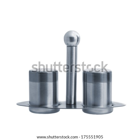 Metal salt and pepper shakers on stand and isolated on white background, studio shot, two objects, front angle - stock photo