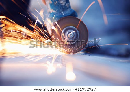 Metal sawing with sparkles close up - stock photo