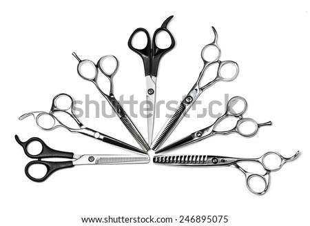 Metal scissors isolated on white background - stock photo