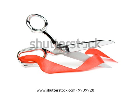Metal scissors with red ribbon. Isolated on white - stock photo