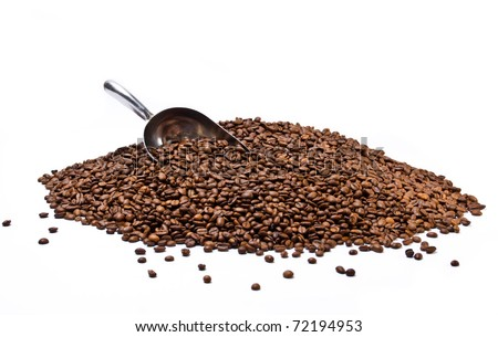 Metal scoop partially burried in coffee beans heap isolated on white background - stock photo