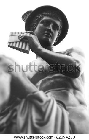 metal sculpture of Hermes on a white background - stock photo