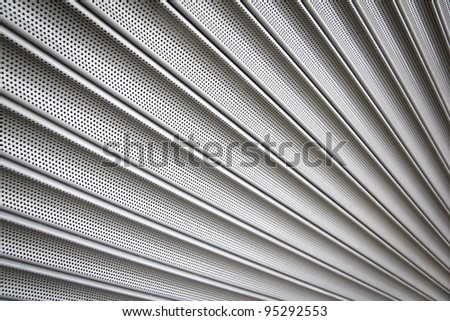 metal security shutters protecting a small shop when closed - stock photo