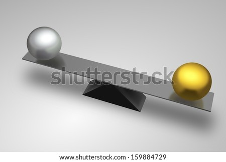 Metal seesaw with golden and silver balls - stock photo