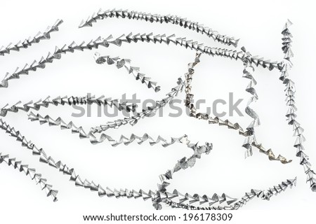 Metal shavings on white background - stock photo