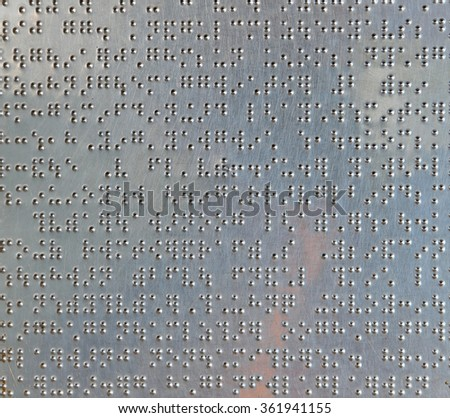 Metal sheet with braille dots background - stock photo