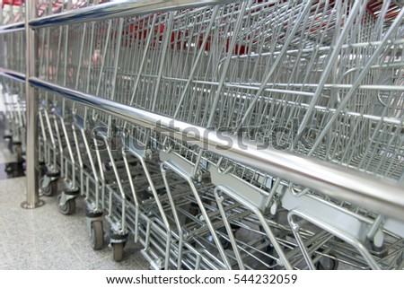 Metal Shop Carts on Blurred Background Near the Store
