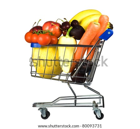 metal shopping trolley filled with vegetable and fruit - stock photo