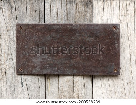 Metal sign on wood plank background - stock photo