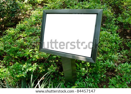 Metal signboard with copy space in green plant background - stock photo