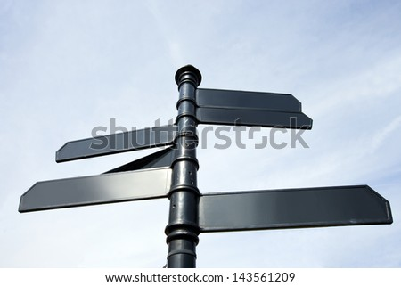 Metal signs pointing in all sort of directions in London, UK - stock photo