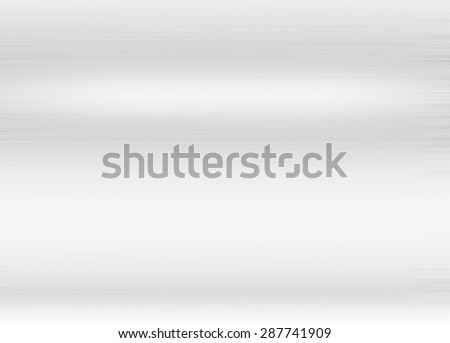 Metal silver background or texture of brushed steel plate with reflections