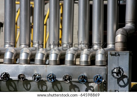 metal silver tube with iron tap - stock photo