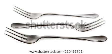Metal small dessert forks isolated on white