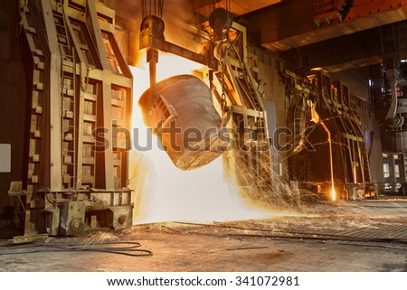Metal smelting furnace in steel mills - stock photo