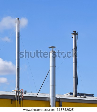 Metal smoke stacks of a factory building